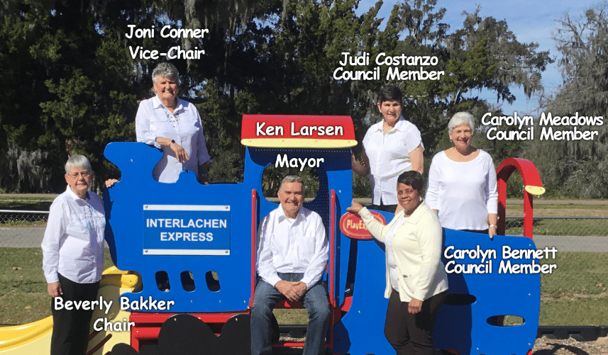 Town Council Slide- L-R - Beverly Baker, Joni Conner, Ken Larsen, Judi Constanzo, Carolyn Meadows, and Carlyn Bennett and Other Picture is Interlachen Town office